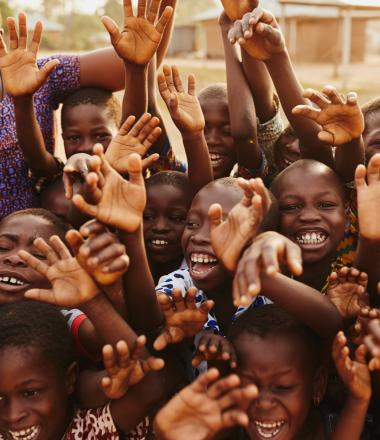 A group of happy and smiling school children in Ghana