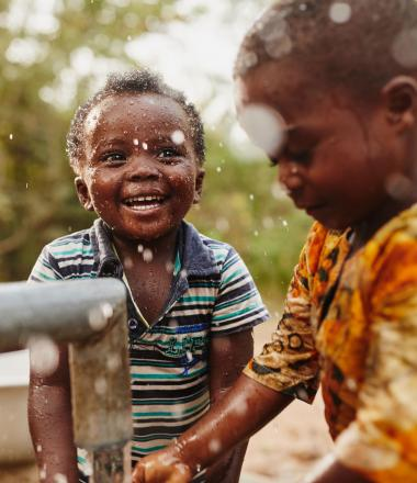 A boy plays in the water in Ghana