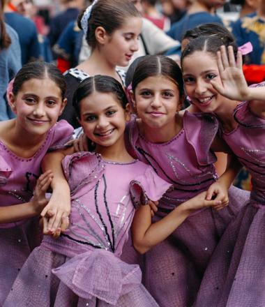 Armenian girls in purple dance dresses