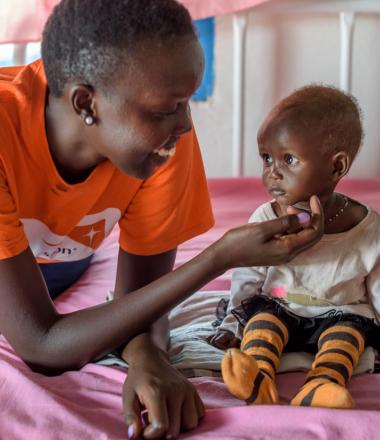 World Vision feeding malnourished child