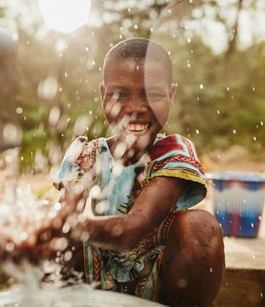 Child splashing clean water