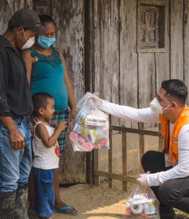 World Vision staff in Latin America bring supplies to vulnerable family