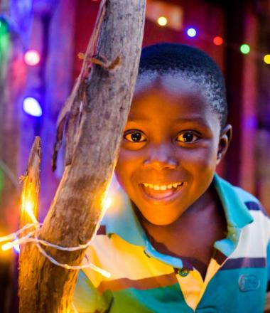 Child with chiristmaslights