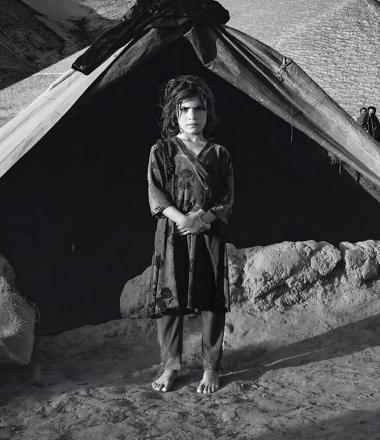 Girl standing in front of tent