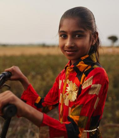 girl child with bike in Asia