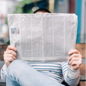 A man reads the newspaper