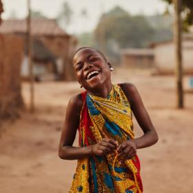 A girl smiles in Ghana