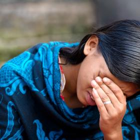 Lucky cries as she shares her story in Bangladesh