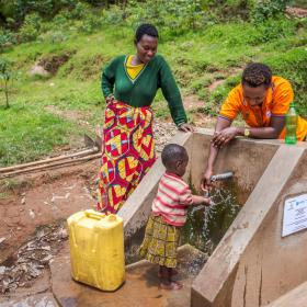 A World Vision employee in Africa showcases a water pump.