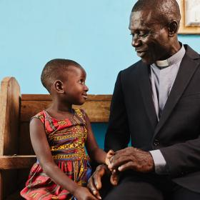A pastor and child in a church