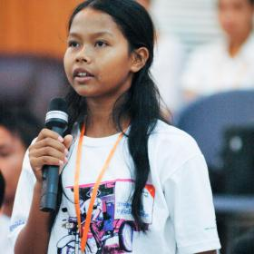 Young Khmer lady speaking on a microphone
