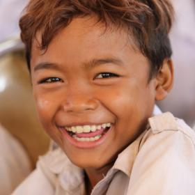 Khmer boy laughing at the camera