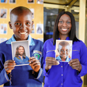 Mary and Yinka holding each other's photos