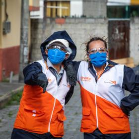 Two World Vision staff members is protective gear against COVID-19