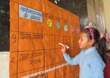 A Nepal girl writes in school
