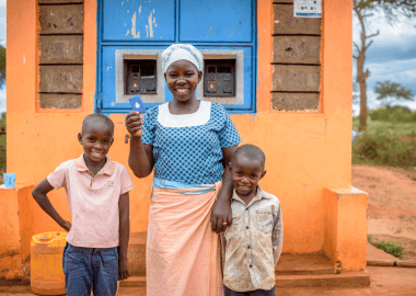 Mother with two children Grundfos Wrold Vision Partnership