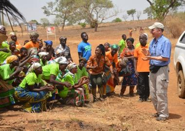Tony being welcomed by lead farmers and fire volunteers in Yameriga