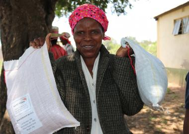 Vulnerable farmer with her sorghum and cow peas seeds from World Vision