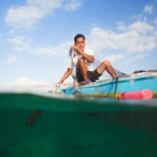 A fisherman in the Philippines uses a microloan to fund his small business