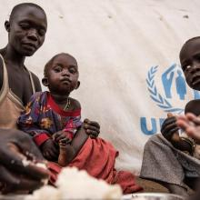 Amandru and her children eat the first proper meal they have eaten in a long time. World Vision and World Food Programme (WFP) serve hot meals to South Sudanese refugees in Uganda.